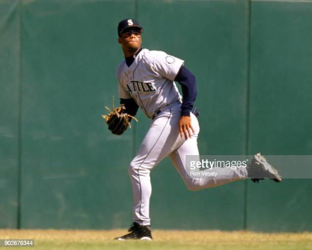 Ken Griffey Jr of the Seattle Mariners fields during an MLB game against the Oakland Athletics at the OaklandAlameda County Coliseum during the 1988...