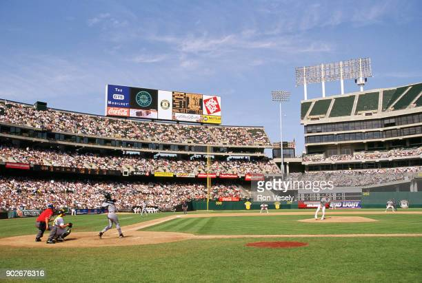 Ken Griffey Jr of the Seattle Mariners hits a home run during an MLB game against the Oakland Athletics at the OaklandAlameda County Coliseum during...