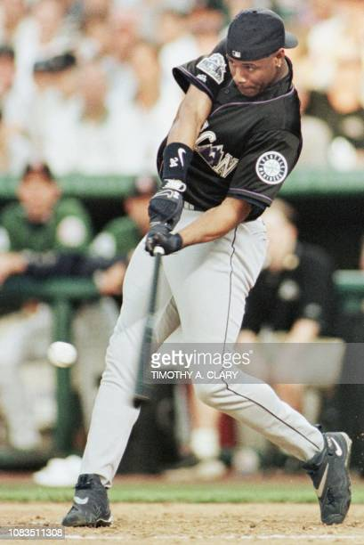 Ken Griffey Jr of the Seattle Mariners hits a home run during the final round 06 July in the 1998 Major League home run derby at Coors Field in...