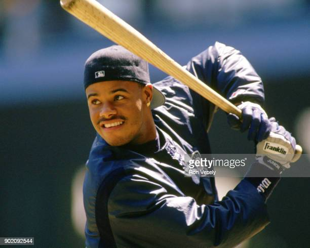 Ken Griffey Jr of the Seattle Mariners looks on during an MLB game versus the Cleveland Indians at Municipal Stadium in Cleveland Ohio during the...