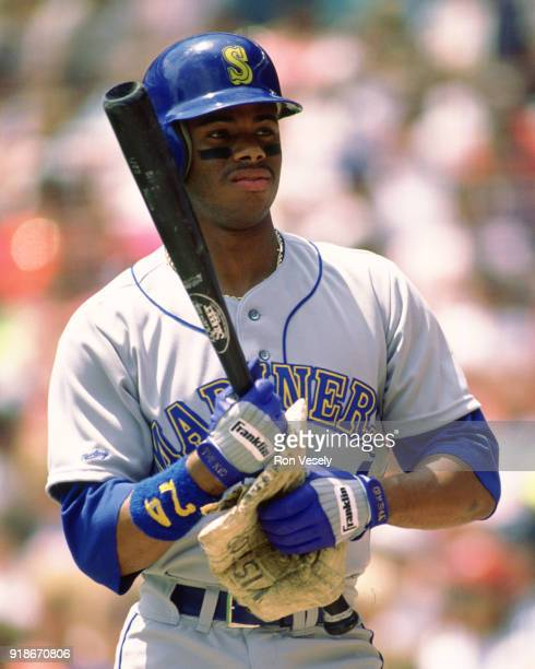 Ken Griffey Jr of the Seattle Mariners looks on during an MLB game against the Milwaukee Brewers at County Stadium in Milwaukee Wisconsin during the...