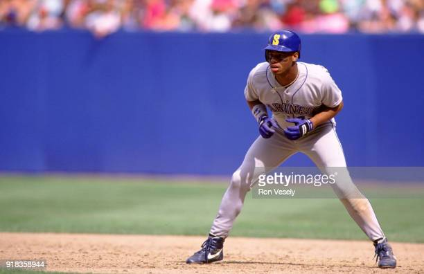 Ken Griffey Jr of the Seattle Mariners runs the bases during an MLB game against the Cleveland Indians at Municipal Stadium in Cleveland Ohio during...