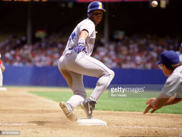 Ken Griffey Jr of the Seattle Mariners slides into third base during an MLB game against the Cleveland Indians at Municipal Stadium in Cleveland Ohio...