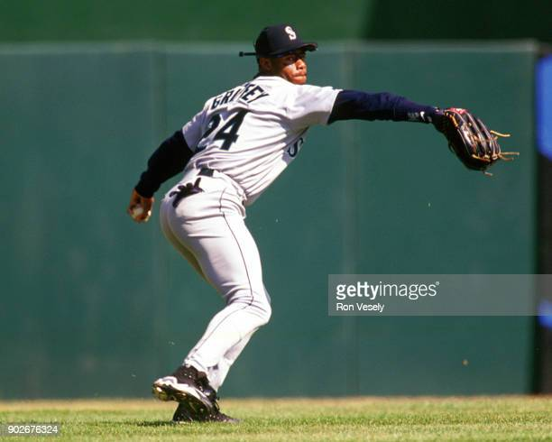 Ken Griffey Jr of the Seattle Mariners throws the ball in from the outfield during an MLB game against the Oakland Athletics at the OaklandAlameda...