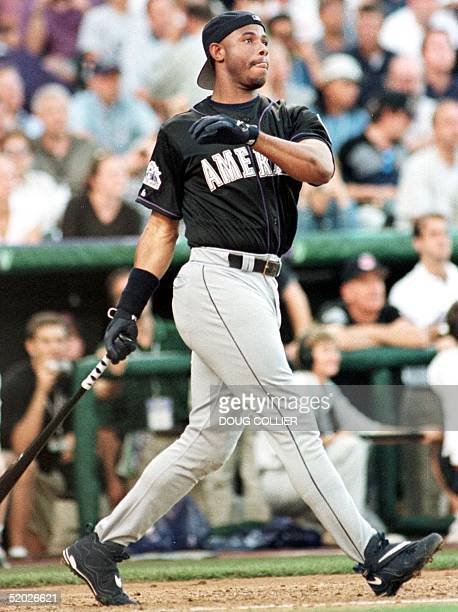 Ken Griffey Jr of the Seattle Mariners watches a home run during the first round 06 July in the 1998 Major League home run derby at Coors Field in...
