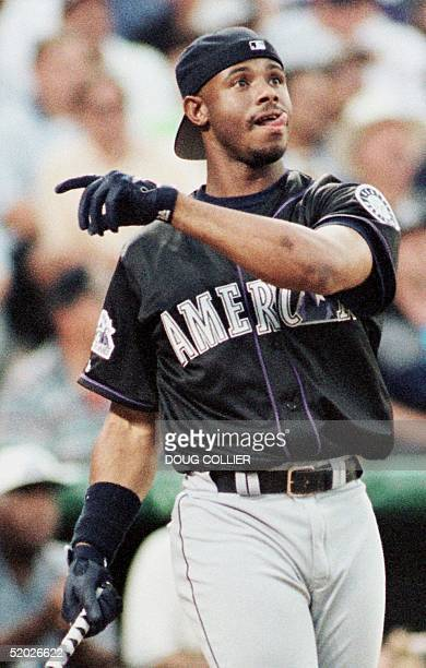 Ken Griffey Jr. Of the Seattle Mariners watches a home run during the final round 06 July in the 1998 Major League home run derby at Coors Field in...