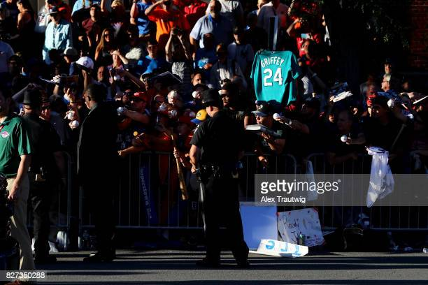 Ken Griffey Jr signs autographs during the 2017 Hall of Fame Parade of Legends at the National Baseball Hall of Fame on Saturday July 29 2017 in...