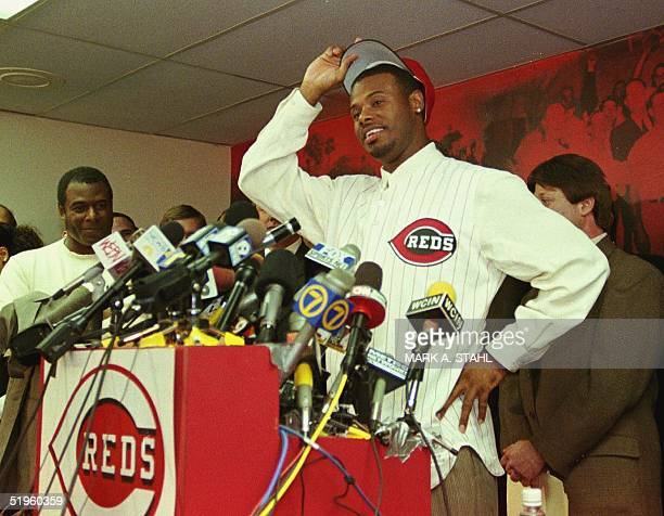 Ken Griffey Jr., slips on a Cincinnati Reds cap during a press conference in Cincinnati, Ohio, 10 February, 2000. Griffey was traded by the Seattle...