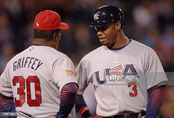 Ken Griffey Jr speaks with his father and first base coach Ken Griffey Sr of the USA during a timeout in action in the '06 World Baseball Classic at...