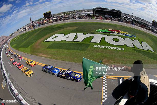 Ken Griffey Jr waves the green flag as Chase Elliott driver of the NAPA Auto Parts Chevrolet leads the field to the green flag to start the NASCAR...