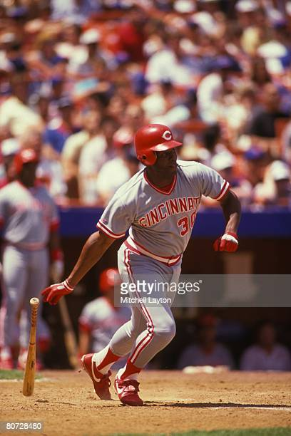 Ken Griffey Sr. #30 of the Cincinnati Reds bats during a baseball game against the New York Mets on July 15, 1990 at Shea Stadium in New York, New...