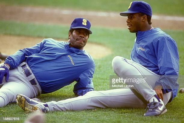 Ken Griffey Sr and Ken Griffey Jr #24 of the Seattle Mariners talk before a baseball game against the Baltimore Orioles on September 5 1990 at...