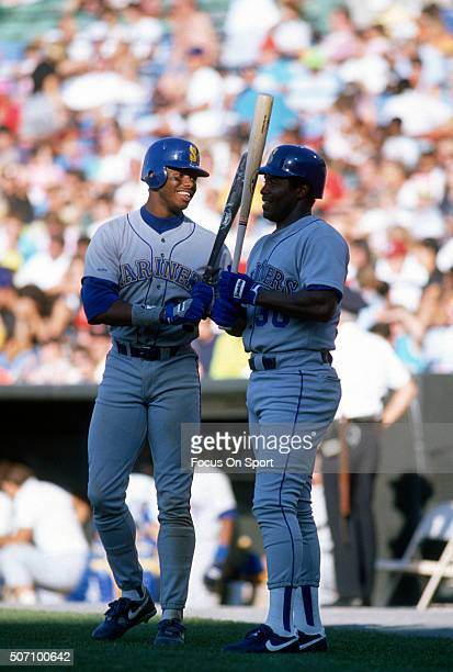 Ken Griffey Sr and Ken Griffey Jr of the Seattle Mariners chats standing in the ondeck circle against the Baltimore Orioles during a Major League...