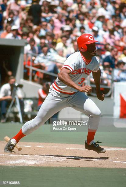 Ken Griffey Sr of the Cincinnati Reds puts the ball in play and runs towards first base against the Philadelphia Phillies during a Major League...