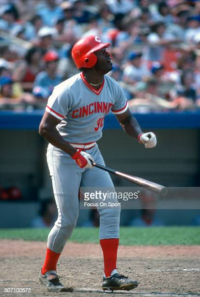 Ken Griffey Sr of the Cincinnati Reds swings and watches the flight of his ball against the New York Mets during a Major League Baseball game circa...