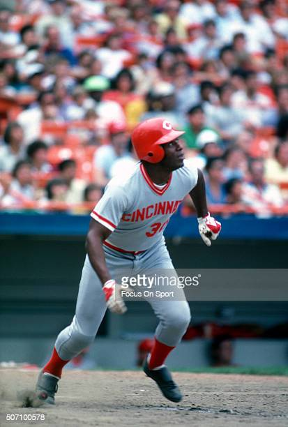 Ken Griffey Sr of the Cincinnati Reds watches the flight of his ball as he runs towards first base against the New York Mets during a Major League...