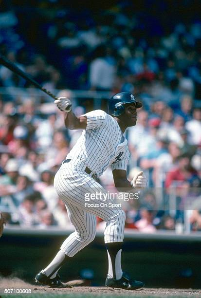 Ken Griffey Sr of the New York Yankees swings and watches the flight of his ball during a Major League Baseball game circa 1983 at Yankee Stadium in...