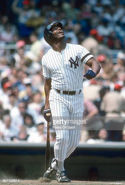 Ken Griffey Sr of the New York Yankees swings and watches the flight of his ball during a Major League Baseball game circa 1985 at Yankee Stadium in...