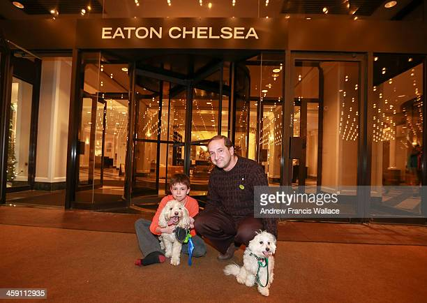 TORONTO ON DECEMBER 22 Ken Gruber marketing director at the Eaton Chelsea poses with Ben a 9monthold Havanese and Grayden Castle and his dog Cody a...