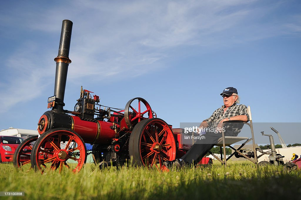 Ken Harness from Grimsby sits next to his 4' Burrell Engine at the steam rally at Duncombe Park on July 7, 2013 in Helmsley, England. The popular steam rally takes place in the magnificent surroundings of the park over the first weekend in July each year and brings together traction engines, working displays, vintage tractors, commercial and military vehicles and vintage cars.