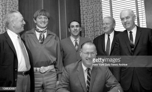 Ken Harrelson appears satisfied as he agrees to join Indians after lengthy conference with prez Gabe Paul Indians Robert Woolf his attorney AL prez...