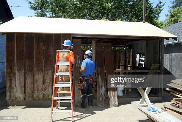 Ken Hendrickson, left, and Jimmy Reyes work on a portion of the 'HP garage' on the grounds of 367 Addison Ave. In Palo Alto, California Thursday,...