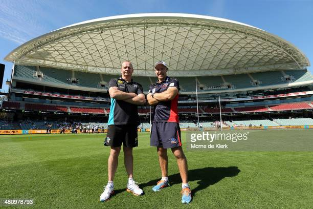Ken Hinkley of Port Adelaide Power and Brenton Sanderson of the Adelaide Crows pose for a photograph after an AFL press conference at Adelaide Oval...