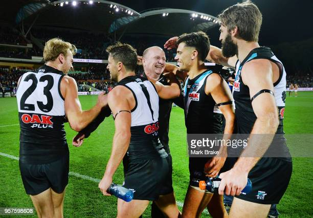 Ken Hinkley Port Adelaide coach celebrates with his players after the round eight AFL match between the Port Adelaide Power and the Adelaide Crows at...