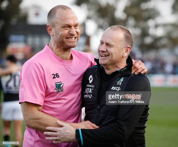 Ken Hinkley Senior Coach of the Power celebrates with Chad Cornes during the 2017 AFL round 22 match between the Western Bulldogs and the Port...