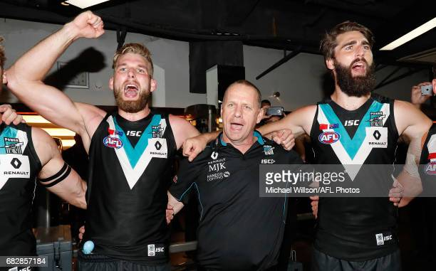 Ken Hinkley Senior Coach of the Power sings the song with his players during the 2017 AFL round 08 match between the Gold Coast Suns and Port...