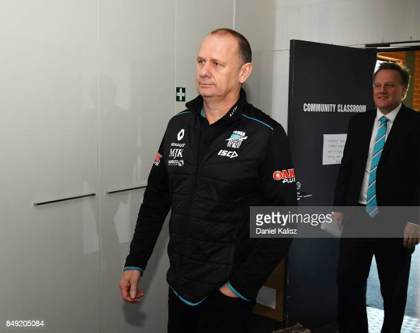 Ken Hinkley the coach of the Power and Port Adelaide chief executive Keith Thomas walk into the press conference at Alberton Oval on September 19...