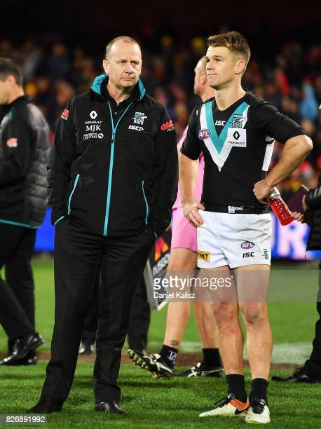 Ken Hinkley the coach of the Power and Robbie Gray of the Power look on after the round 20 AFL match between the Adelaide Crows and the Port Adelaide...