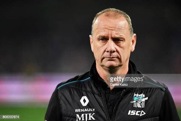 Ken Hinkley the coach of the Power looks on prior to the round 15 AFL match between the Port Adelaide Power and the Richmond Tigers at Adelaide Oval...