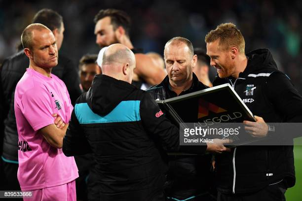 Ken Hinkley the coach of the Power makes changes as Chad Cornes runner for the Power looks on during the round 23 AFL match between the Port Adelaide...