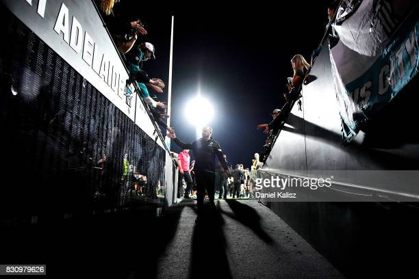 Ken Hinkley the coach of the Power walks from the field after during the round 21 AFL match between Port Adelaide Power and the Collingwood Magpies...