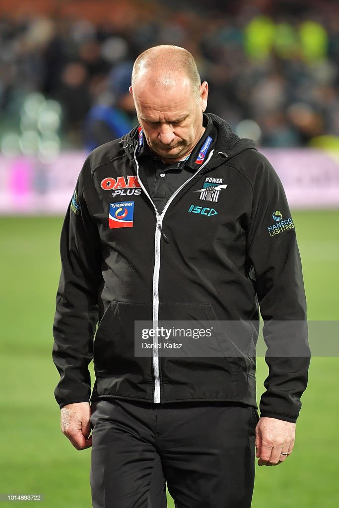 Ken Hinkley the coach of the Power walks from the field looking dejected after the round 21 AFL match between the Port Adelaide Power and the West Coast Eagles at Adelaide Oval on August 11, 2018 in Adelaide, Australia.