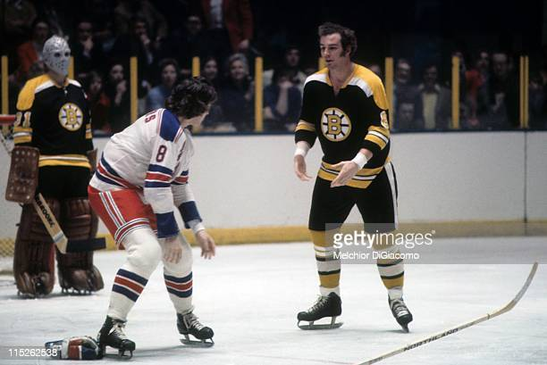 Ken Hodge of the Boston Bruins drops the gloves to fight Steve Vickers of the New York Rangers circa 1973 at the Madison Square Garden in New York...