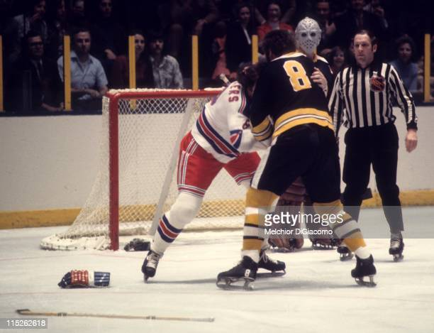 Ken Hodge of the Boston Bruins fights with Steve Vickers of the New York Rangers during their game circa 1973 at the Madison Square Garden in New...