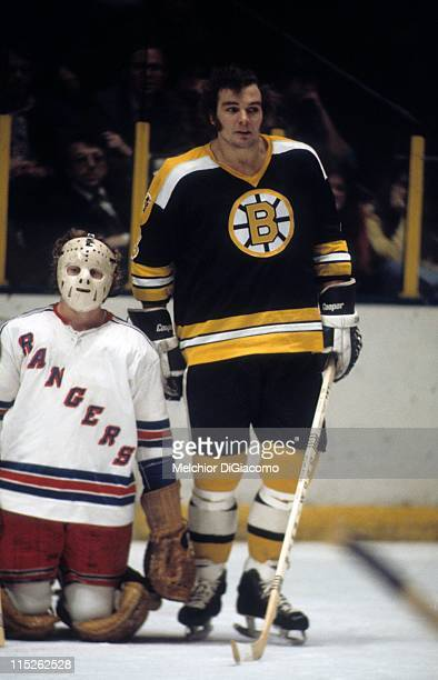 Ken Hodge of the Boston Bruins stands on the ice next to goalie Peter McDuffe of the New York Rangers after the play had stopped on January 4 1974 at...