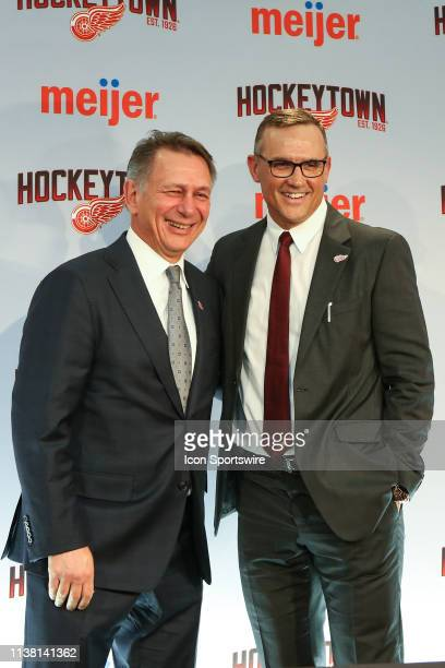 Ken Holland and Steve Yzerman pose for photographs during a press conference to introduce Steve Yzerman as the new Executive Vice President and...