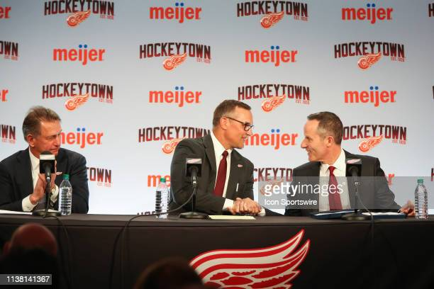 Ken Holland claps his hands as Steve Yzerman and Detroit Red Wings Governor President and CEO Christopher Illitch shake hands during a press...