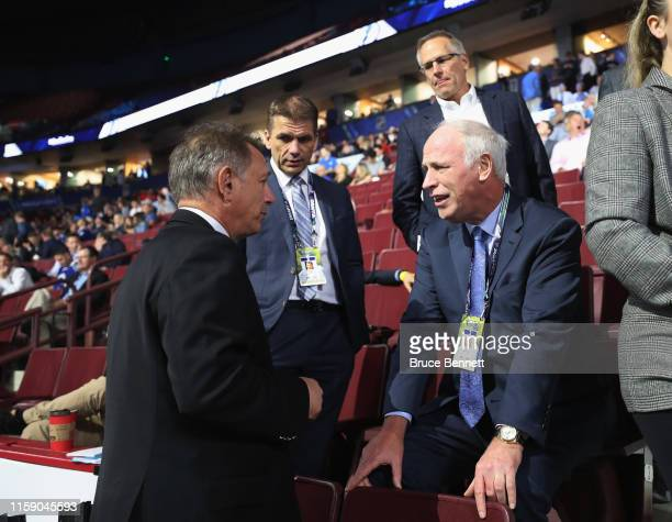 Ken Holland of the Edmonton Oilers chats with agent Don Meehan during the 2019 NHL Draft at the Rogers Arena on June 22 2019 in Vancouver Canada