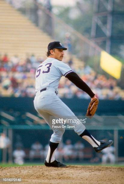Ken Holtzman of the New York Yankees pitches against the Baltimore Orioles during a Major League Baseball game circa 1976 at Memorial Stadium in...