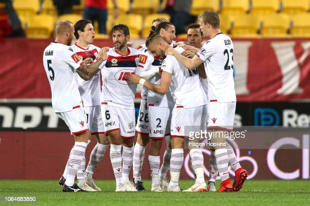 Ken Ilso Larsen of Adelaide United celebrates with teammates after scoring a goal during the round five ALeague match between the Wellington Phoenix...