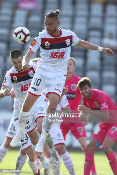 Ken Ilso of Adelaide heads the ball during the round three A-League match between the Central Coast Mariners and Adelaide United at Central Coast...