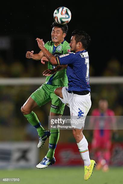 Ken Iwao of Shonan Bellmare and Yuto Sato of JEF United Chiba compete for the ball during the J League second division match between Shonan Bellmare...