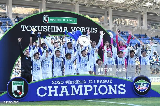 Ken Iwao of Tokushima Vortis lifts the trophy after the J.League Meiji Yasuda J2 match between Avispa Fukuoka and Tokushima Vortis at the Best Denki...