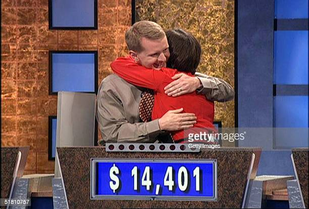 Ken Jennings hugs Nancy Zerg after losing to her during a taping of the game show Jeopardy September 7 2004 in Culver City California Jennings...