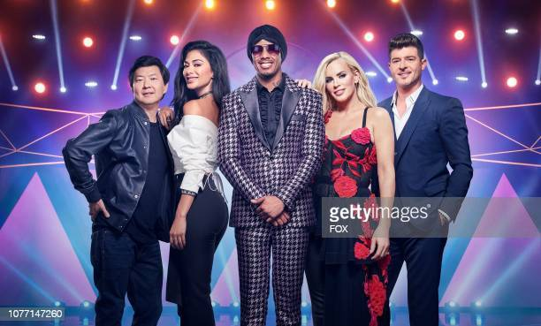 Ken Jeong Nicole Scherzinger Nick Cannon Jenny McCarthy and Robin Thicke in THE MASKED SINGER premiering Wednesday Jan 2 on FOX