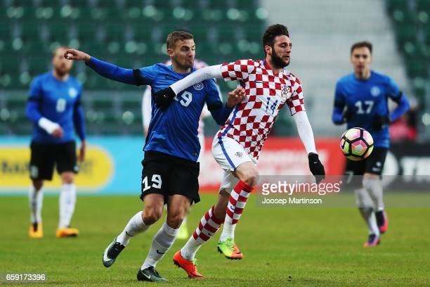 Ken Kallaste of Estonia competes with Duje Cop of Croatia during international friendly between Estonia and Croatia at A le Coq Arena on March 28...